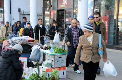 Local shoppers stroll the streets looking at different produce from around the world.